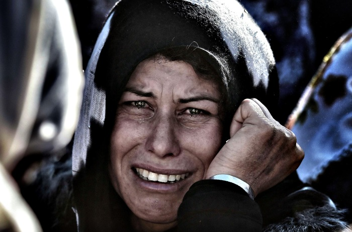 A woman cries during the funeral of a Ku...A woman cries during
