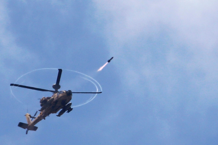 An Israeli Apache helicopter fires a missile towards the Gaza Strip
