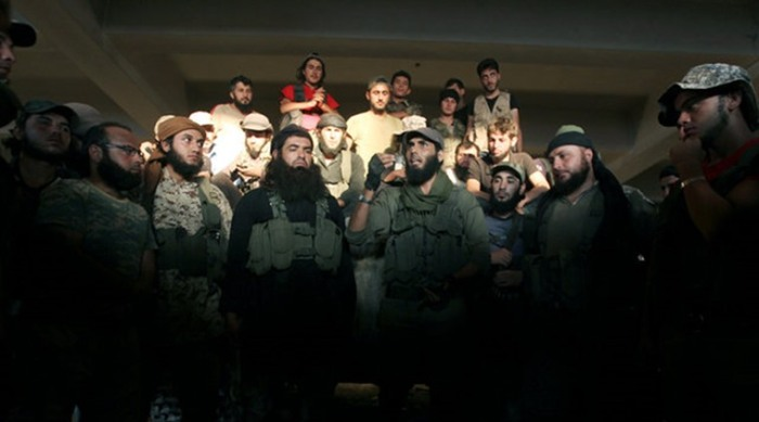 Rebel fighters gather in an artillery academy of Aleppo