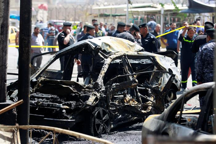 A wreckage of a car is seen at the site of car bomb attack near a government office in Karkh district in Baghdad