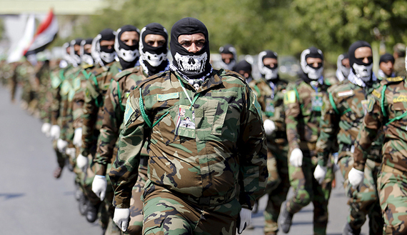 Iraqi Shiite Muslim men from Hashid Shaabi (Popular Mobilization) march during a parade marking the annual al-Quds Day, or Jerusalem Day, on the last Friday of the Muslim holy month of Ramadan in Baghdad