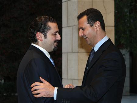 Syria's President Assad welcomes Lebanese Prime Minister Hariri at the Teshrin presidential palace in Damascus