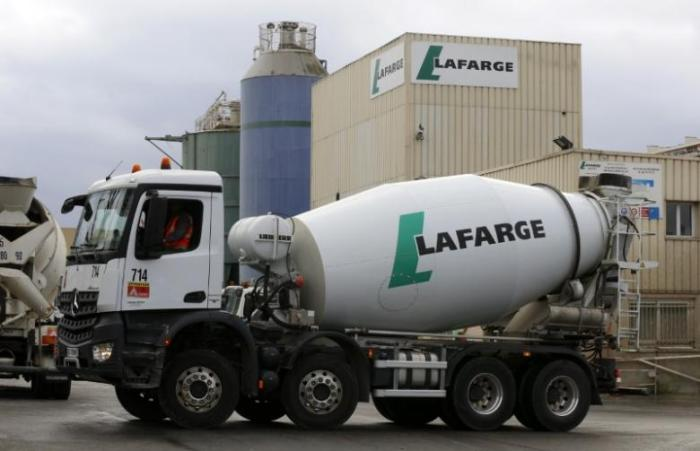 The logo of French building material Lafarge is seen on cement trucks at a production plant in Paris